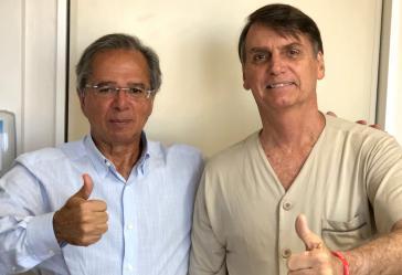 Paulo Guedes (li.) und Brasiliens Präsident Jair Bolsonaro