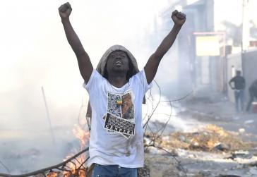 """Die Demonstranten in Haiti fordern den Rücktritt des Präsidenten und fragen """"Wo ist das Geld von Petrocaribe?"""" (Screenshot)"""