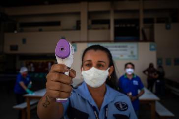 Corona-Prävention in Manaus, Brasilien. Währenddessen stellte Bolsonaro die Zahlung an die WHO ein