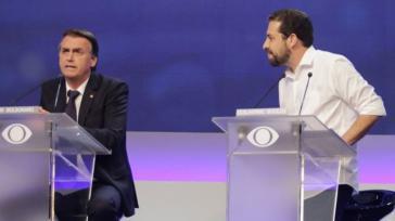 2018 stritten Bolsonaro und Boulos in einer TV-Debatte. 2020 ließ Bolsonaro gegen den linken Kontrahänten ermitteln.